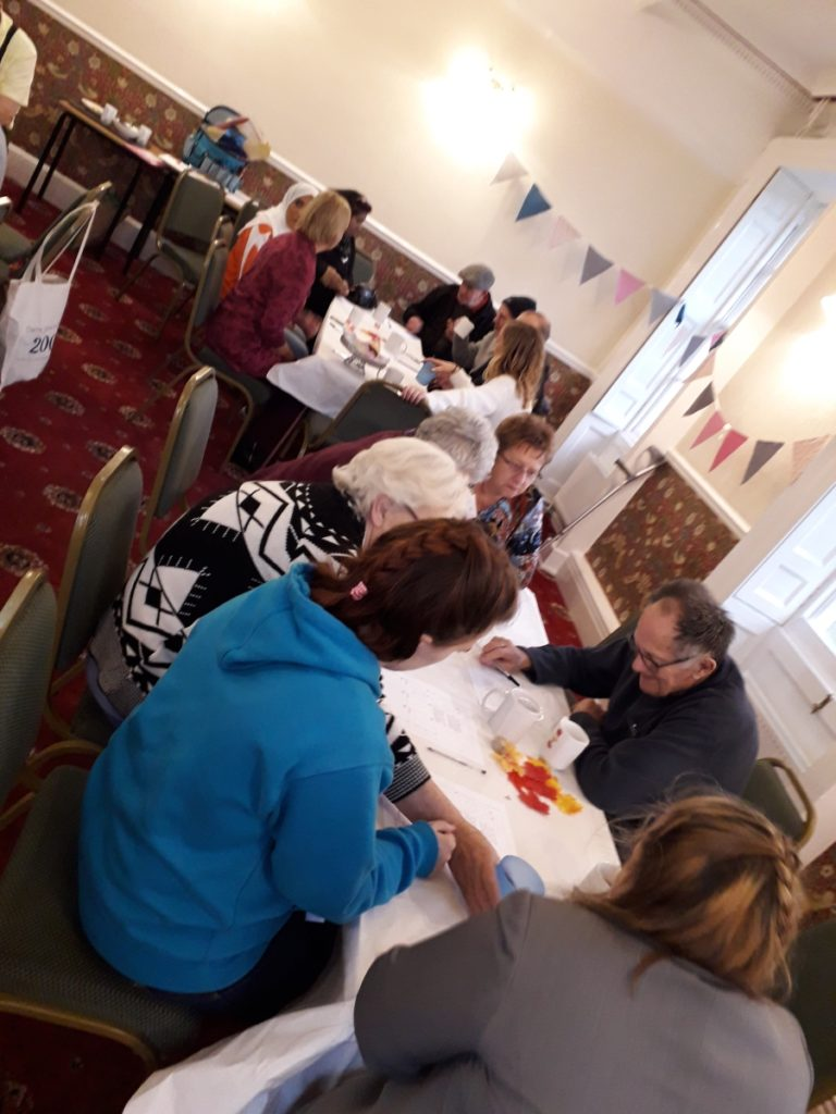 People at the Dementia Cafe playing games