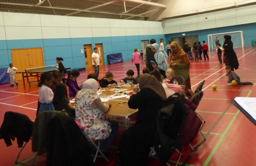 People enjoying a school holiday event at English Institute of Sport