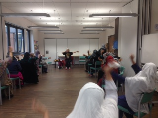 Photo of women waving their arms at Chairobics class
