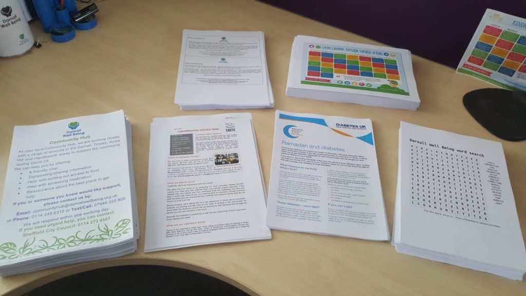 Photo of printed sheets in stacks, ready to be put together as activity packs