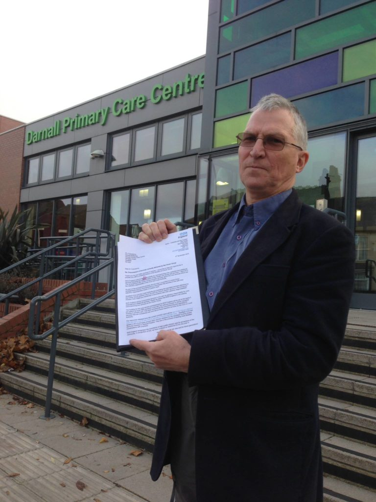 Photo of Darnall Primary Care Centre with DWB founder Jack Czauderna standing outside