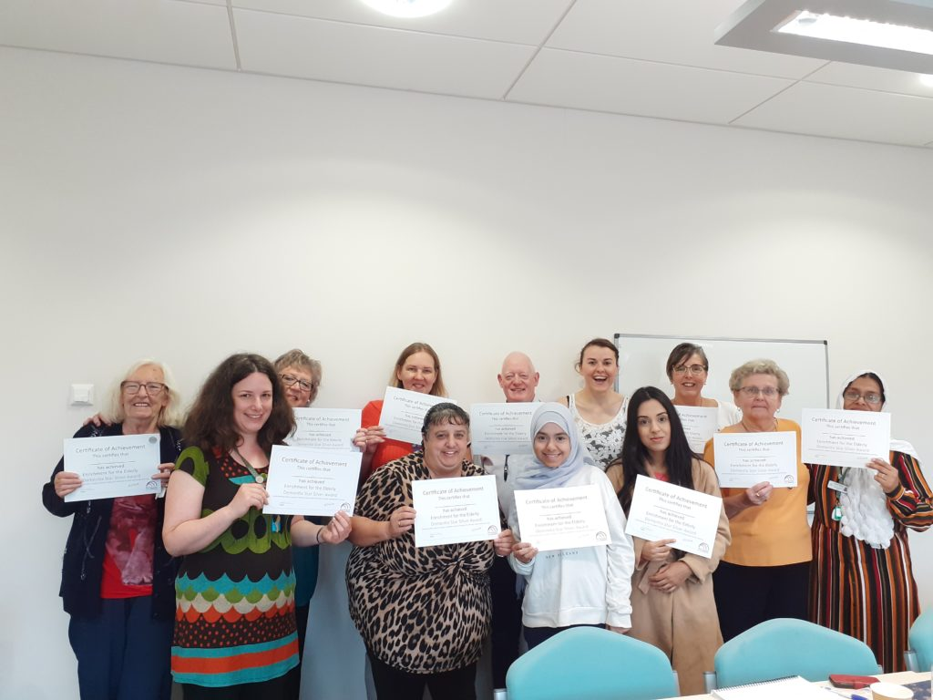 Photo of volunteers and staff at Darnall Well Being holding certificates from Dementia Silver Award training