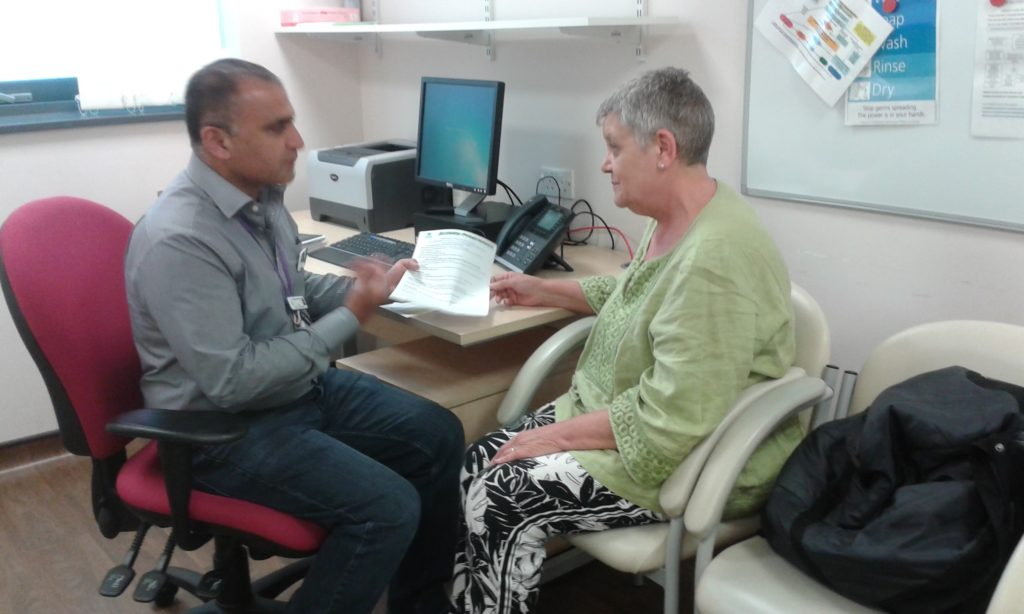 Photo of Waqas, one of our Senior Health Workers, talking with a client