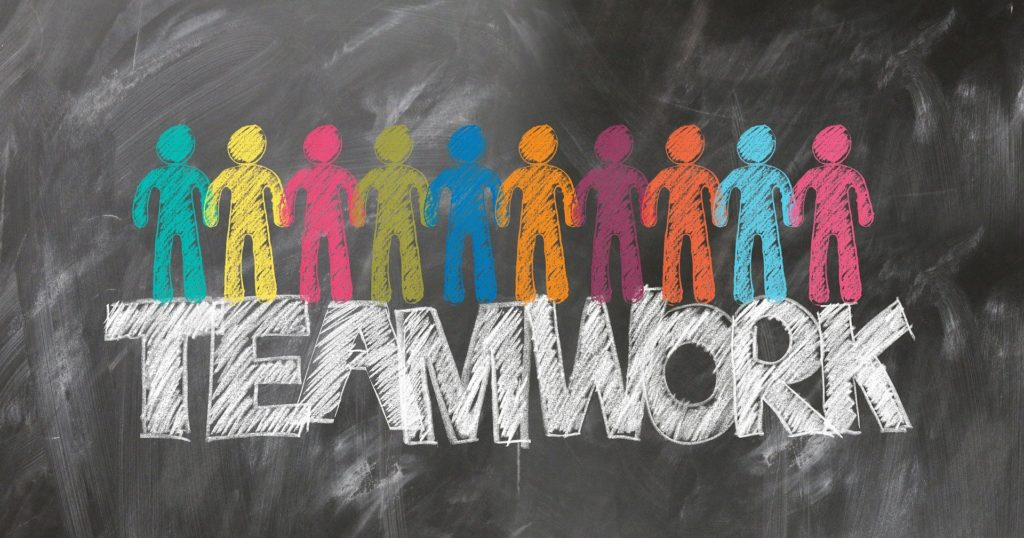 colourful drawing of people and the word Teamwork
