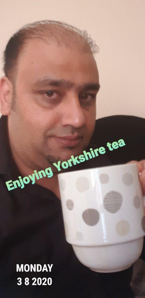 Photo of man enjoying a cup of tea