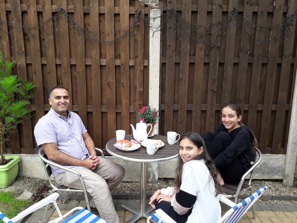 Photo of Hameed family members enjoying a cup of tea in the garden