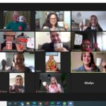 Screenshot of a Zoom call with a number of people holding up cups of tea
