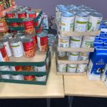 photo of tins and cartons of food