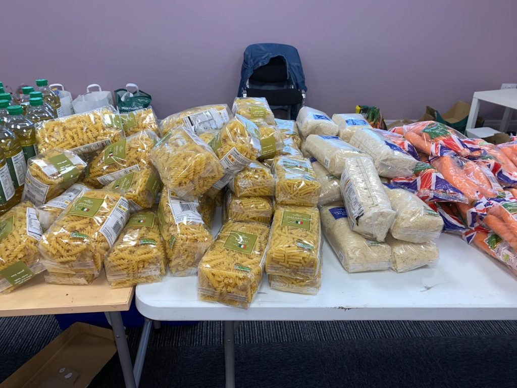 photo of bags of pasta, rice and carrots