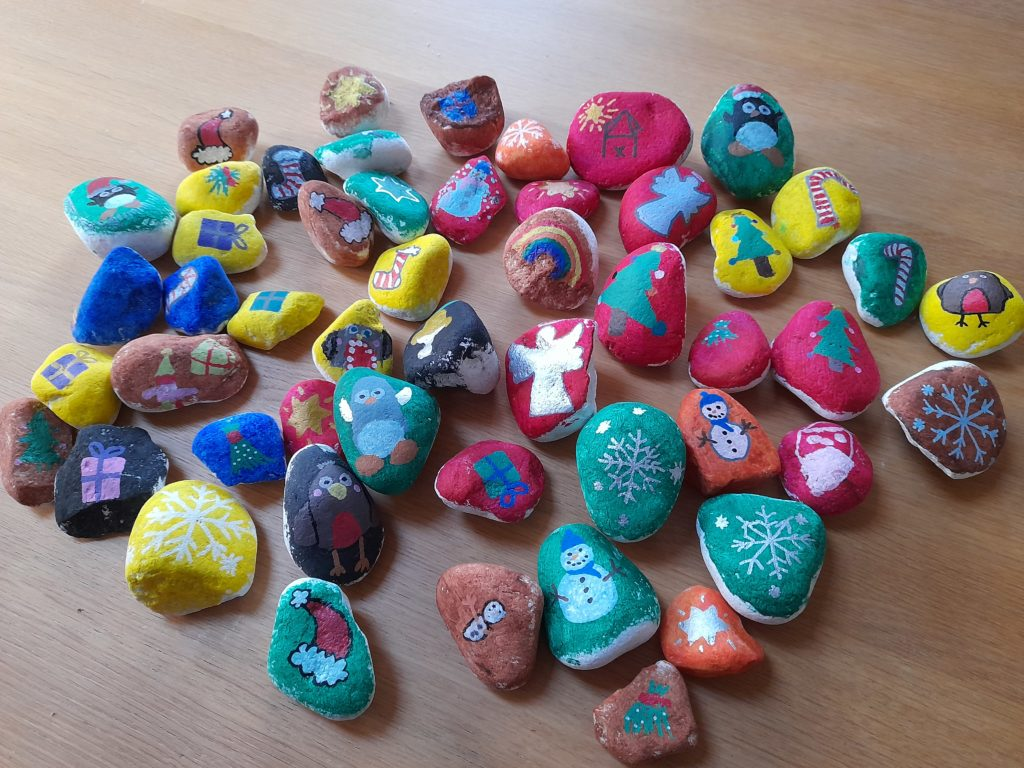 photo of pebbles painted with Christmas images
