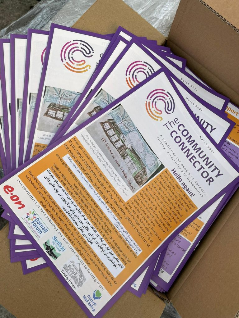 photos of a stack of newsletters