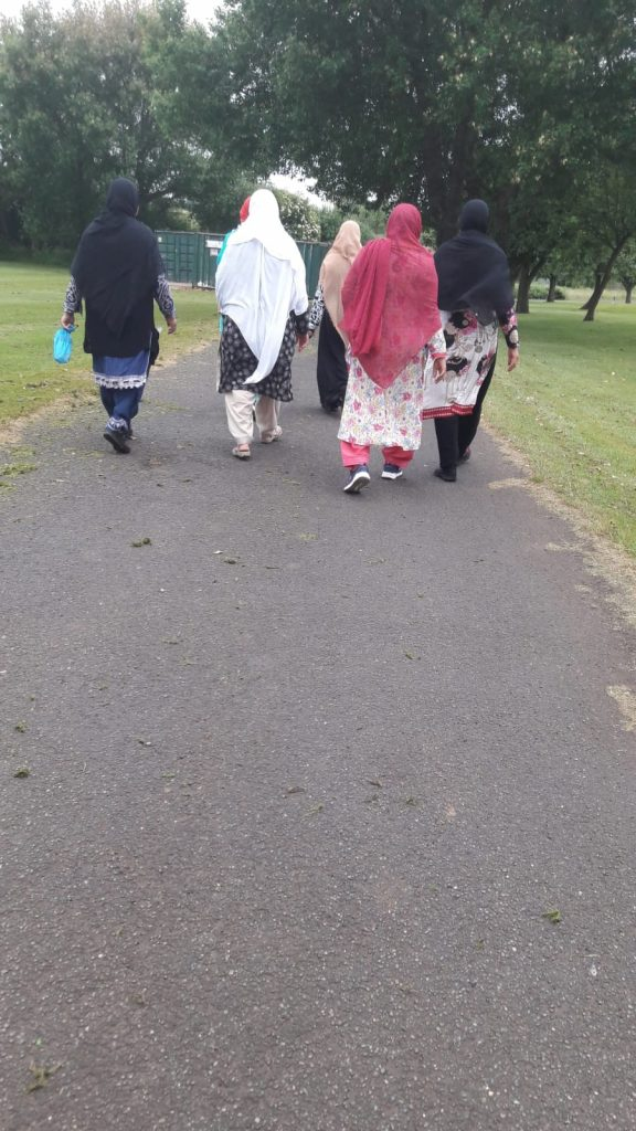 photo from behind of a group of women walking together