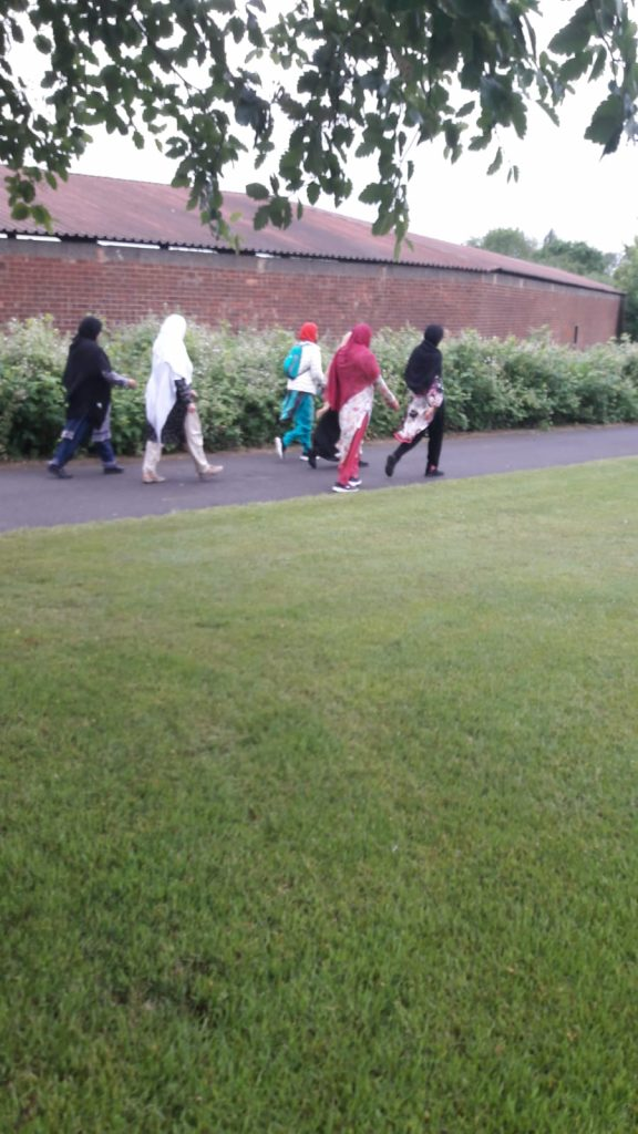 photo of women walking together