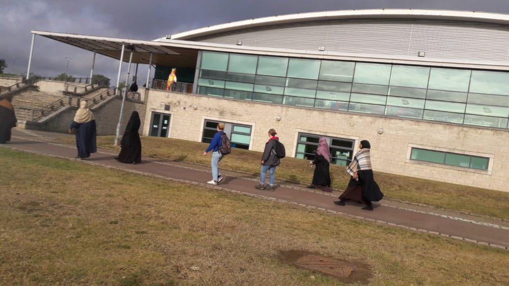 women walking by a school